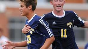 Massapequa's Peter Meyer, left, gets congratulated by teammate