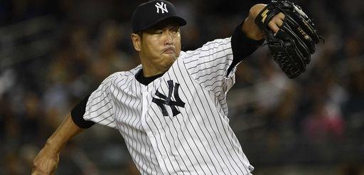 Yankees starting pitcher Hiroki Kuroda delivers against the