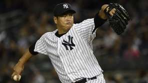 Yankees starting pitcher Hiroki Kuroda delivers against the