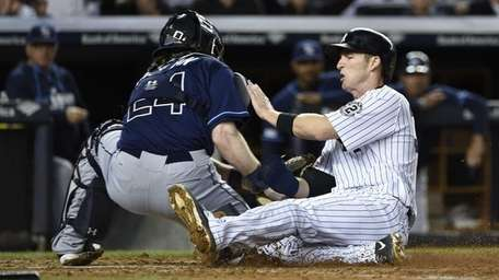 Yankees second baseman Stephen Drew is tagged out