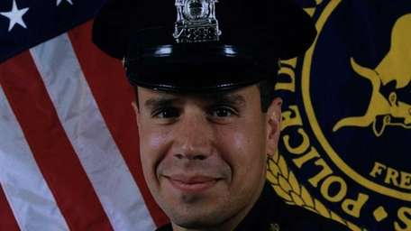 A Suffolk Police Department detective John Oliva, shown