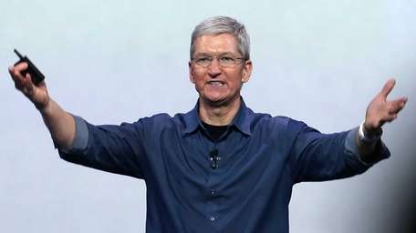 Apple CEO Tim Cook speaks as the company
