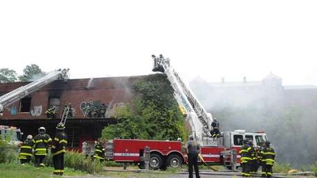 Firefighters from nine departments battle a morning blaze,