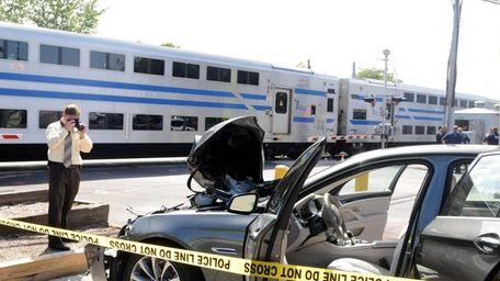 MTA investigators work at the scene of a