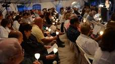About 150 people attended a candlelight vigil at