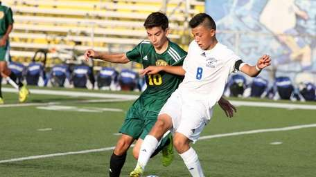 Lawrence's Josue Siguenza, right, tries to keep the