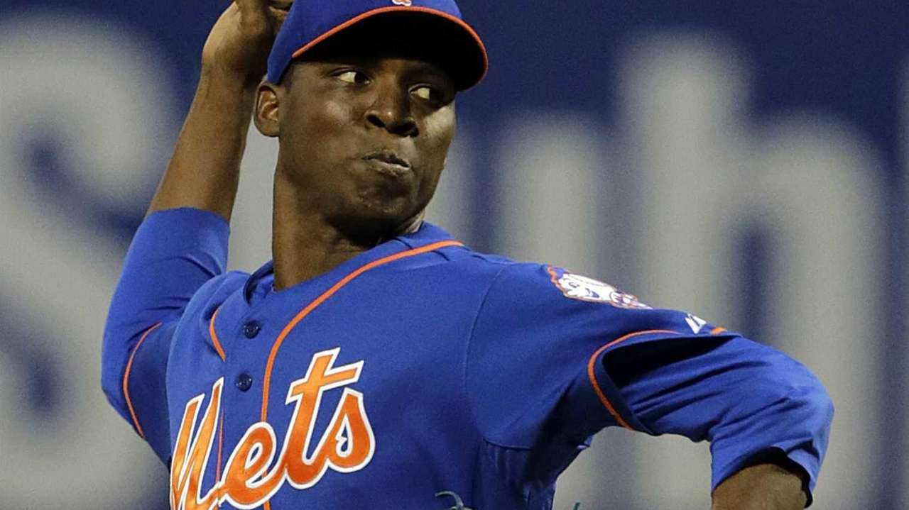 Mets starting pitcher Rafael Montero delivers in the
