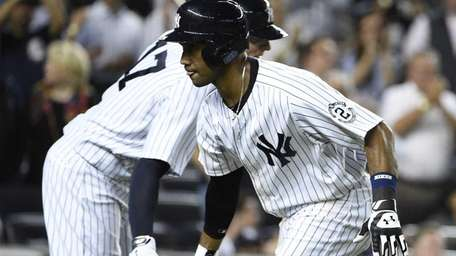 Yankees left fielder Chris Young, right, is congratulated