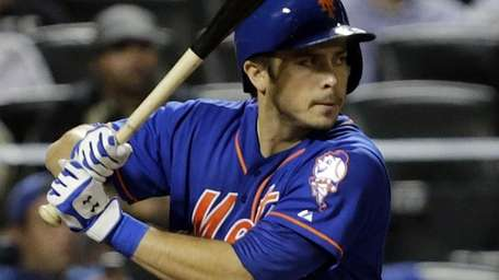 Mets catcher Travis d'Arnaud bats in the bottom