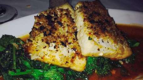 Swordfish is served with broccoli rabe, olives and