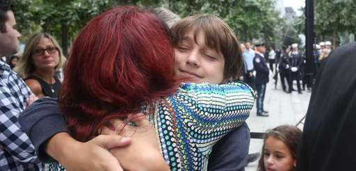 Alex Mori of Westchester County hugs her godson