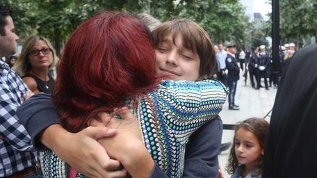 Alex Mori of Westchester County hugs her godson