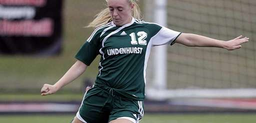 Lindenhurst's Rebecca Conway clears the ball in the