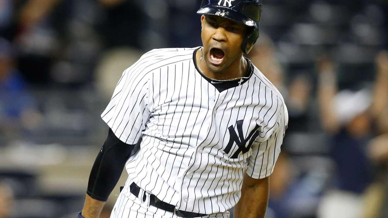 Chris Young of the Yankees celebrates his game-winning,