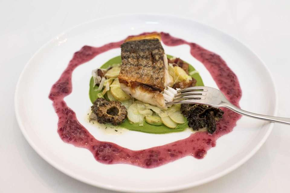 Pan-roasted local striped bass is served on a