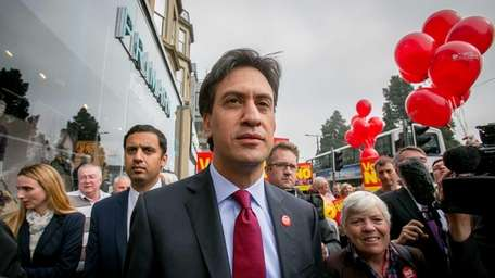 Labour Party leader Ed Miliband speaks with supporters