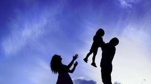 Silhouettes of parents with their children.