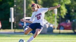 Cold Spring Harbor's Caitlin Hooks kicks the ball