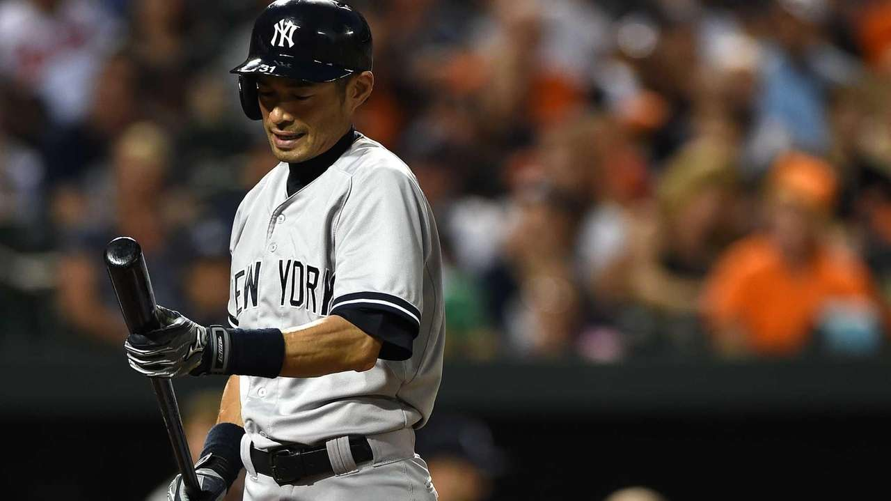 Ichiro Suzuki of the Yankees reacts after fouling