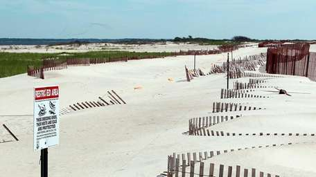 Sand fences and orange markers just east of