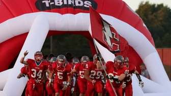 Connetquot charges onto the field before a game
