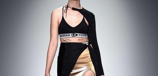 A model walks the runway at the Nasir
