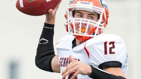 Carey quarterback Michael Catanese attempts a pass in