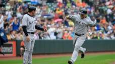 Brian McCann of the Yankees celebrates with third