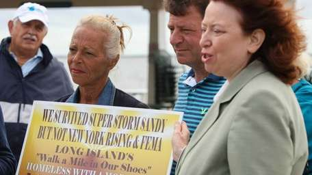 From left, Anna D'Amaro of Island Park holds