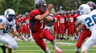 Smithtown East QB John Daniggelis cuts between two