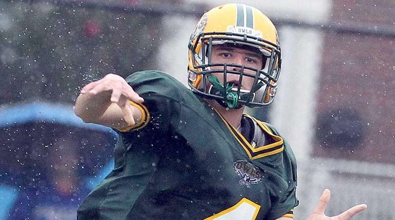 Lynbrook's Zach LoCicero completes a pass to teammate