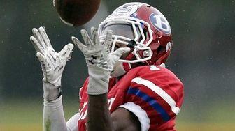 Bellport wide receiver Andrew Trent hauls in a