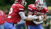 Bellport quarterback Nick Fountis hands the ball off