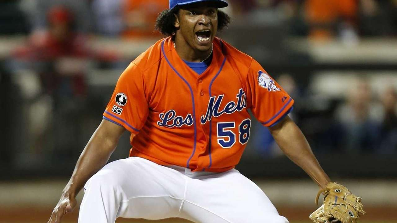 Jenrry Mejia of the Mets celebrates after defeating