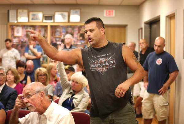 Bohemia resident Steve Zaino criticizes the commissioners of