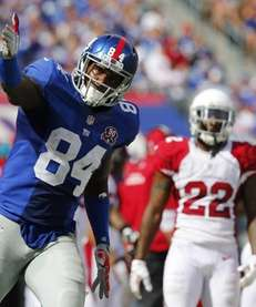 Larry Donnell #84 of the Giants signals first