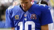 Eli Manning #10 of the Giants stands on