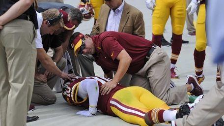 Washington Redskins quarterback Robert Griffin III (10) is
