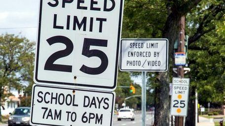 A speed limit sign is seen along Stewart