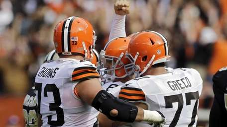 Cleveland Browns place kicker Billy Cundiff is mobbed