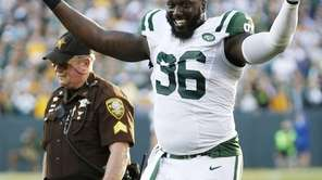 The Jets' Muhammad Wilkerson reacts as he walks