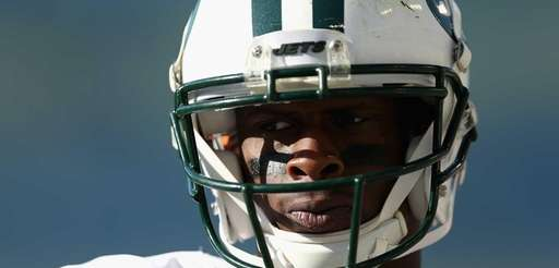 Quarterback Geno Smith of the Jets watches from