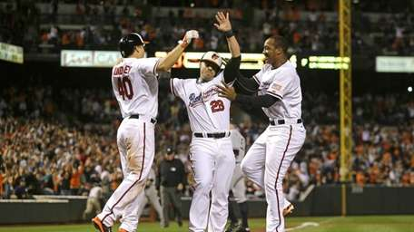 Baltimore Orioles' Steve Pearce, center, celebrates with teammates