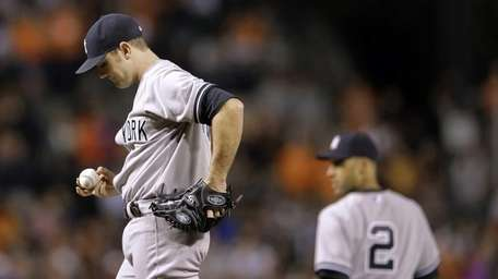Yankees relief pitcher David Robertson pauses after the