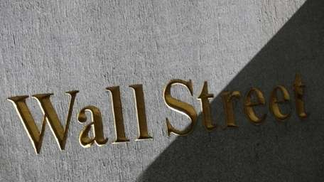 A sign for Wall Street on the side