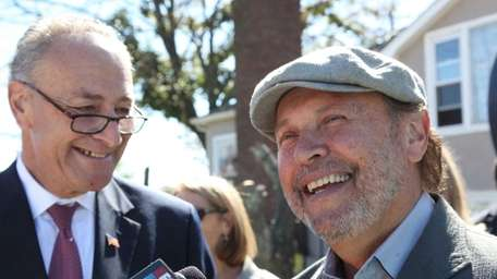 Sen. Charles Schumer, left, and Billy Crystal, right,