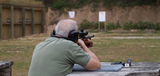 A man fires a rifle at the Islip