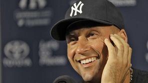 Yankees shortstop Derek Jeter smiles as he answers
