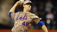 Jacob deGrom of the Mets delivers a pitch