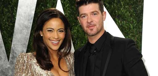Paula Patton and Robin Thicke arrive at the